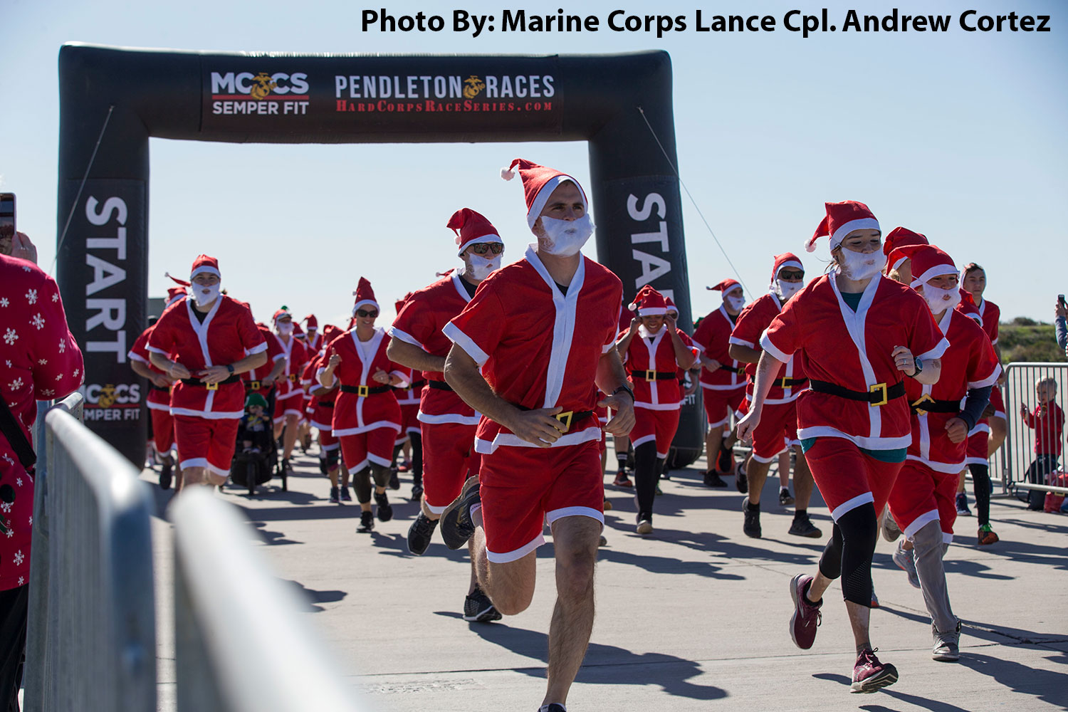 Camp Pendleton, California, December 15, 2019 -  Service members and their families sprint from the starting line during the Santa Run at Marine Corps Base Camp Pendleton.