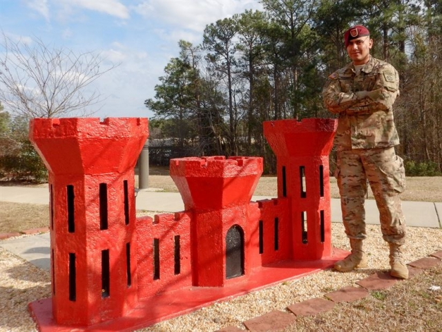 Army Sgt. Ali Alsaeedy, a paratrooper assigned to the 307th Brigade Engineer Battalion, 3rd Brigade Combat Team, 82nd Airborne Division, poses for a photo in front of his unit's engineer castle at Fort Bragg, N.C., March 3, 2017. Army photo by Staff Sgt. Anthony Hewitt