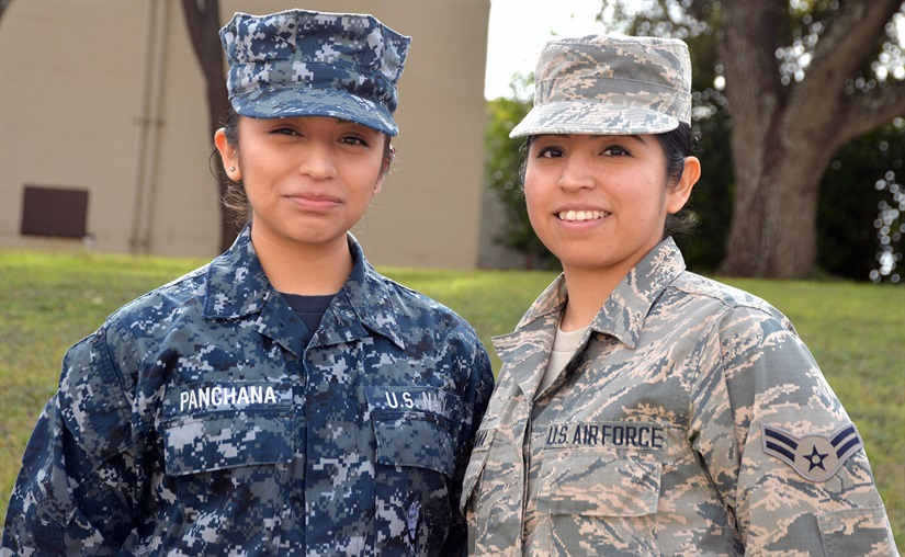 Sisters and service members, Navy Seaman Michelle Panchana, left, and Air Force Airman 1st Class Gisella Panchana are photographed as students together at the Medical Education and Training Campus at Joint Base San Antonio-Fort Sam Houston, Texas, Feb. 9, 2018. They attended school at the base from August 2017 to January 2018. Gisella graduated from the METC Radiology Program Jan. 30, while Michelle is scheduled to complete the METC Pharmacy Program in April. Photo by David DeKunder