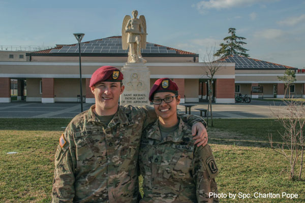 Army Staff Sgts. Zachary and Michelle Evans pose together for a photo outside the 173rd Airborne Brigade Combat Team headquarters building in Vicenza, Italy, after earning their Senior Parachutist Wings together, Jan. 23, 2018. This was the last jump they completed with the unit; it was also the last jump they both needed to obtain the title of Senior Jumpmaster.