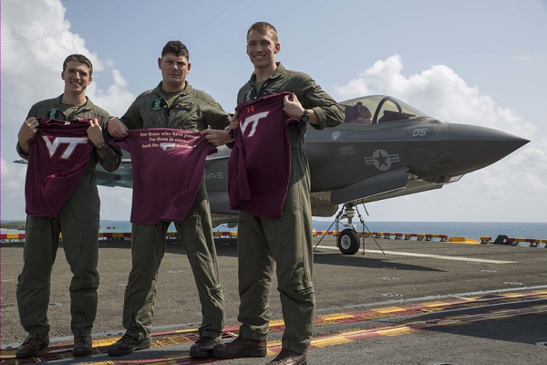 Left to right: Marine Corps aviators Capt. Evan Slusser, Maj. John Stuart and Capt. Andrew Thornberg pose for a photo aboard the amphibious assault ship USS Wasp in the Pacific Ocean, March 15, 2018. The trio are F-35B Lightning II pilots with Marine Fighter Attack Squadron 121, embarked aboard the USS Wasp. All three Marines graduated from Virginia Polytechnic Institute and State University, also known as Virginia Tech, in Blacksburg, Va. Marine Corps photo by Cpl. Bernadette Wildes