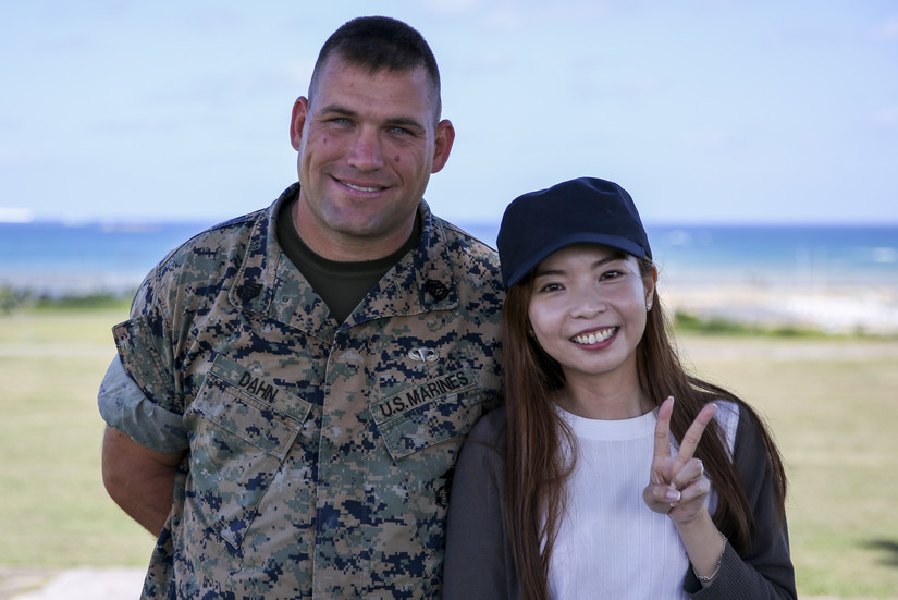 Marine Corps Gunnery Sgt. Scott Michael Dahn and Ching-Yi Sze pose for a photo in Okinawa, Japan, May 24, 2018. Dahn rescued Ching-Yi while she was scuba diving at Okinawa's Maeda Point, May 20, 2018. Photo by Cpl. Andrew Neumann