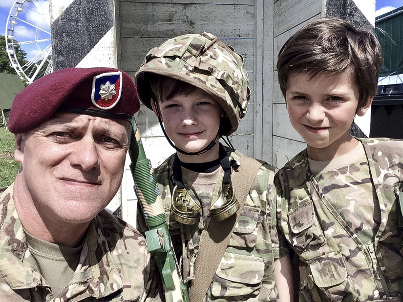 Army Lt. Col. John Hall, a public affairs officer with the 173rd Airborne Brigade Combat Team in Vicenza, Italy, takes a selfie with French boys dressed as soldiers in Sainte-Mere-Eglise, France, June 2, 2018. Hall was participating in the D-Day commemoration and the boys were playing as guards at a campground near the American forces. Photo by Lt. Col. John Hall