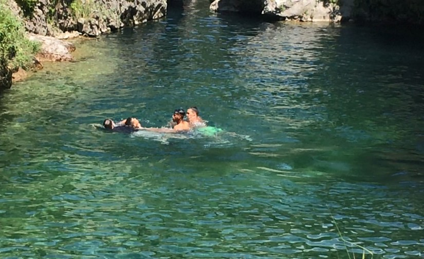 Army Lt. Col. John Hall, a public affairs officer for the 173rd Airborne Brigade Combat Team, saves a man from drowning in the frigid waters of Pria Park, a swimming hole in the Dolomite Mountains of northern Italy, June 17, 2018. The man was challenged to jump from the cliff that surrounds the deep swimming area formed by the melting snows from the surrounding mountains. Photo by Spc. Josselyn Fuentes