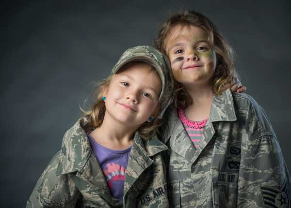 Ava and Sierra, daughters of Staff Sgt. Andrew Stevens, embrace each other on Fort Meade, Md. U.S. Photo by Staff Sgt. Vernon Young Jr.