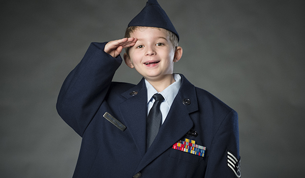 Elliot Banaszynski, son of Staff Sgt. Daniel Banaszynski, imitates his father as he salutes. U.S. Air Force photo by Staff Sgt. Vernon Young Jr.