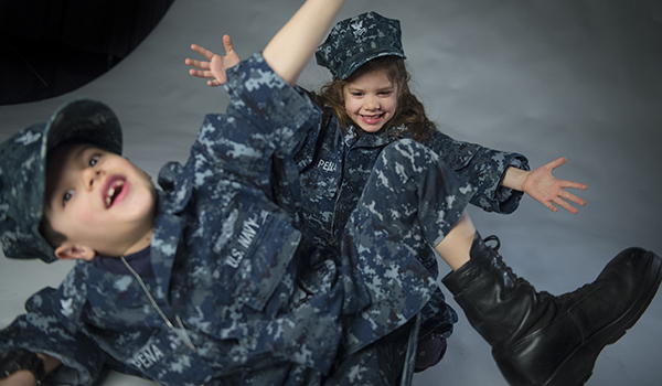 Micajah and Estelle Pena make silly faces for a portrait. U.S. Air Force photo by Staff Sgt. Vernon Young Jr.