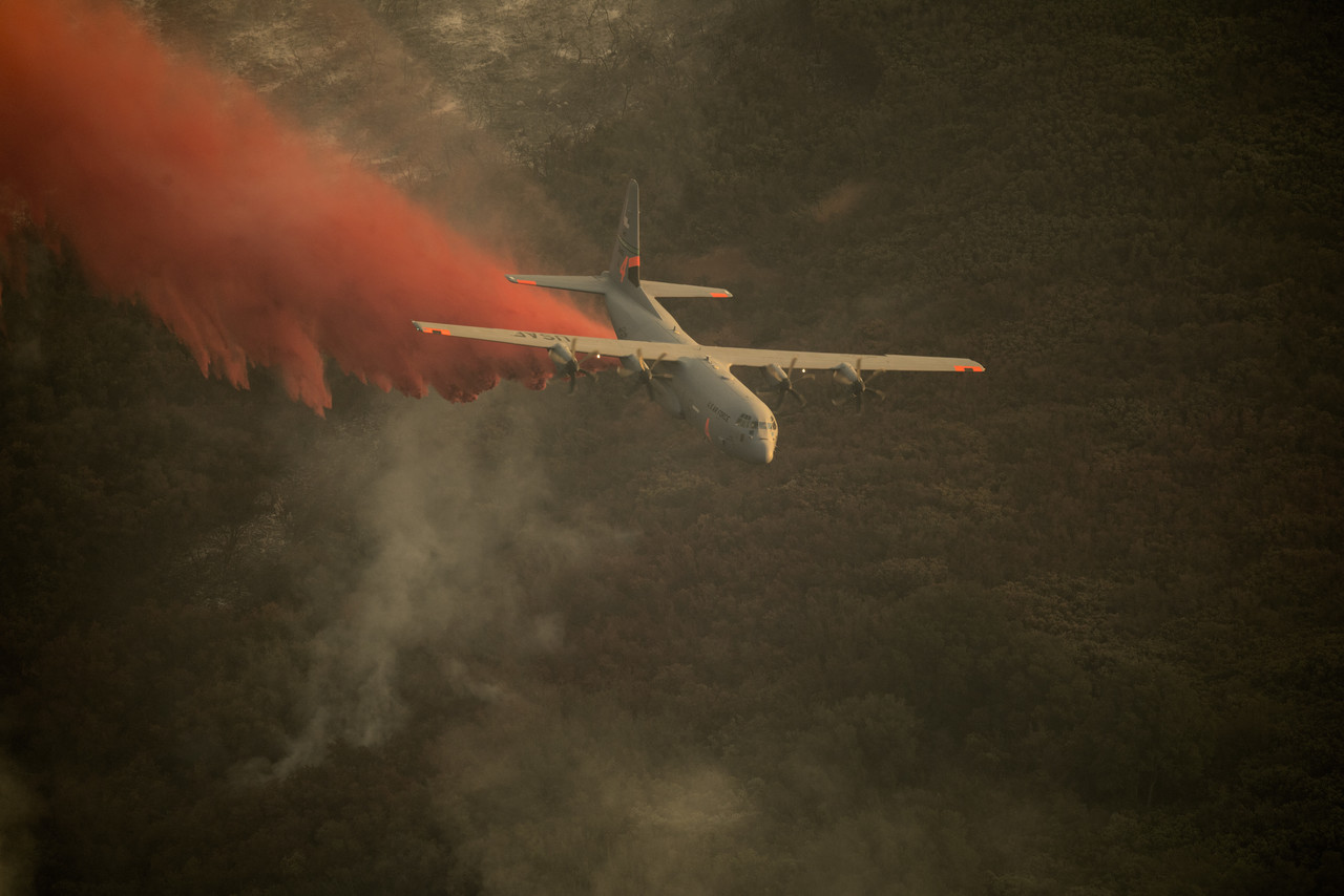 An Air National Guard C-130J Super Hercules aircraft, equipped with the Modular Airborne Fire Fighting System, drops a chemical fire retardant on the Thomas Fire in the hills above the city of Santa Barbara, Calif., Dec. 13, 2017. The C-130J from the 146th Airlift Wing supported Cal Fire's efforts to battle the Thomas Fire raging in Southern California last year. Photo By: DOD photo