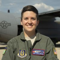 Air Force Reserve Staff Sgt. Annie Lepillez poses for a photo in front of a C-130J Super Hercules. Photo By: DOD photo