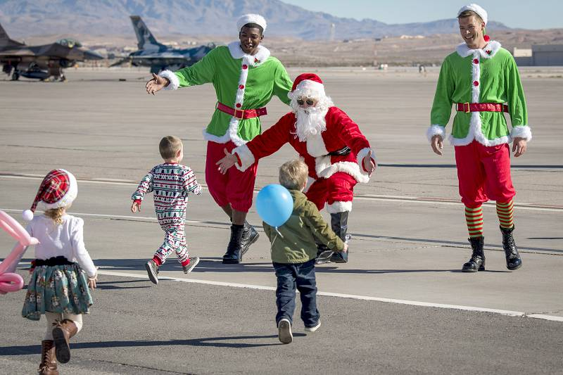 Nellis Air Force Base, Nev., Dec. 15, 2018 –  Santa Claus pays a surprise visit to family members of the Thunderbirds, the Air Force's air demonstration squadron, during the team's holiday party at Nellis Air Force Base.