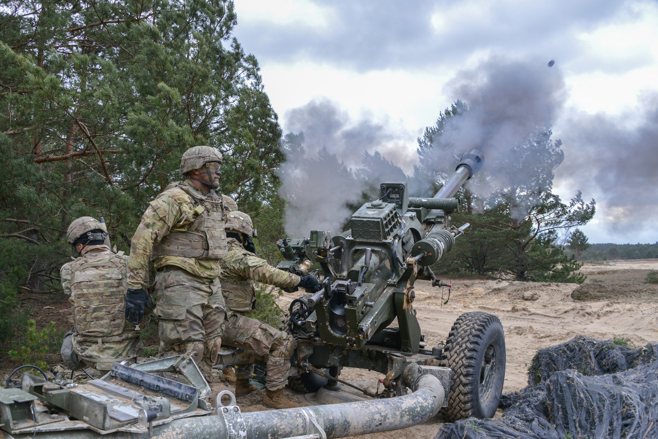Soldiers assigned to Alpha Battery, 4th Battalion, 319th Airborne Field Artillery Regiment, fire a M119 105 mm howitzer during exercise Dynamic Front 19 at Torun, Poland, March 5, 2019. Photo By: Army Spc. Rolyn Kropf