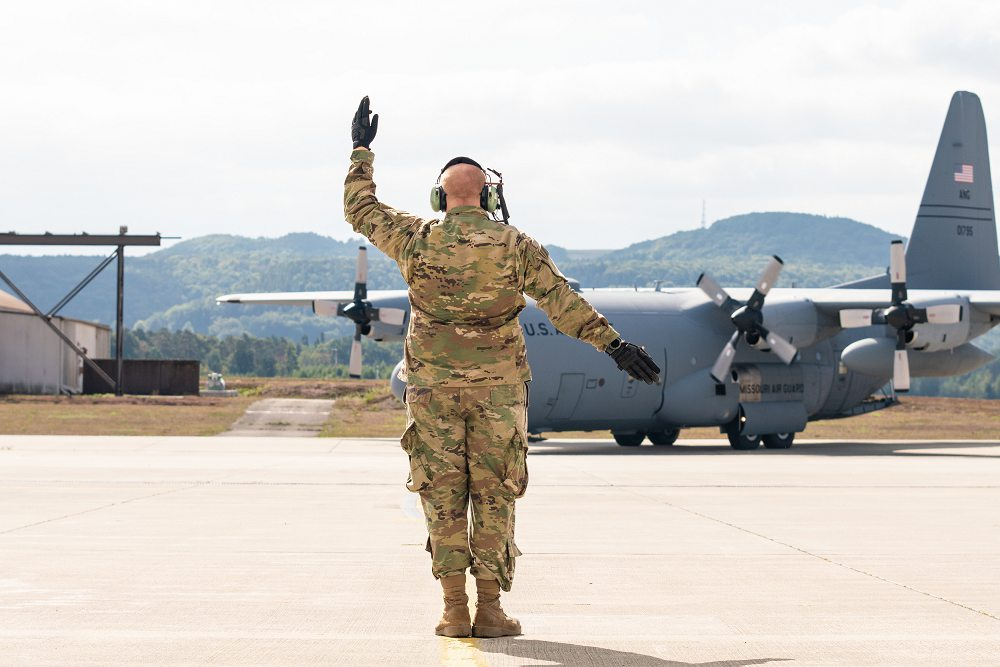 U.S. Air Force Tech. Sgt. Jonathan Jones, with the 139th Airlift Wing, Missouri Air National Guard, marshals in a C-130H Hercules aircraft during Saber Junction 19 at Ramstein Air Base, Germany, Sep. 17, 2019. SJ19 is an exercise involving 16 allies and partner nations at the U.S. Army's Grafenwoehr and Hohenfels Training Areas, Sept. 3-30. (Photo by Tech. Sgt. Patrick Evenson)