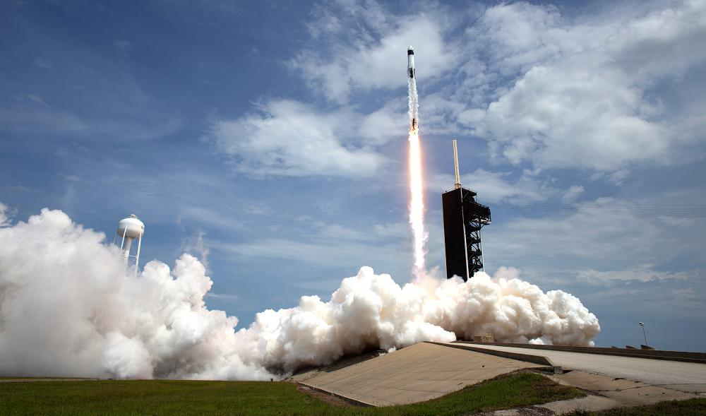 A SpaceX Falcon 9 rocket carrying NASA astronaut and retired Marine Corps Col. Douglas Hurley and fellow crew member Robert Behnken heads skyward during liftoff from Launch Complex 39A at NASA's Kennedy Space Center, Florida, May 30, 2020. The mission marks the resumption of human space flight from the United States. Air National Guard members in Alaska and Hawaii provided support to the launch mission. (NASA photo by Joel Kowsky)