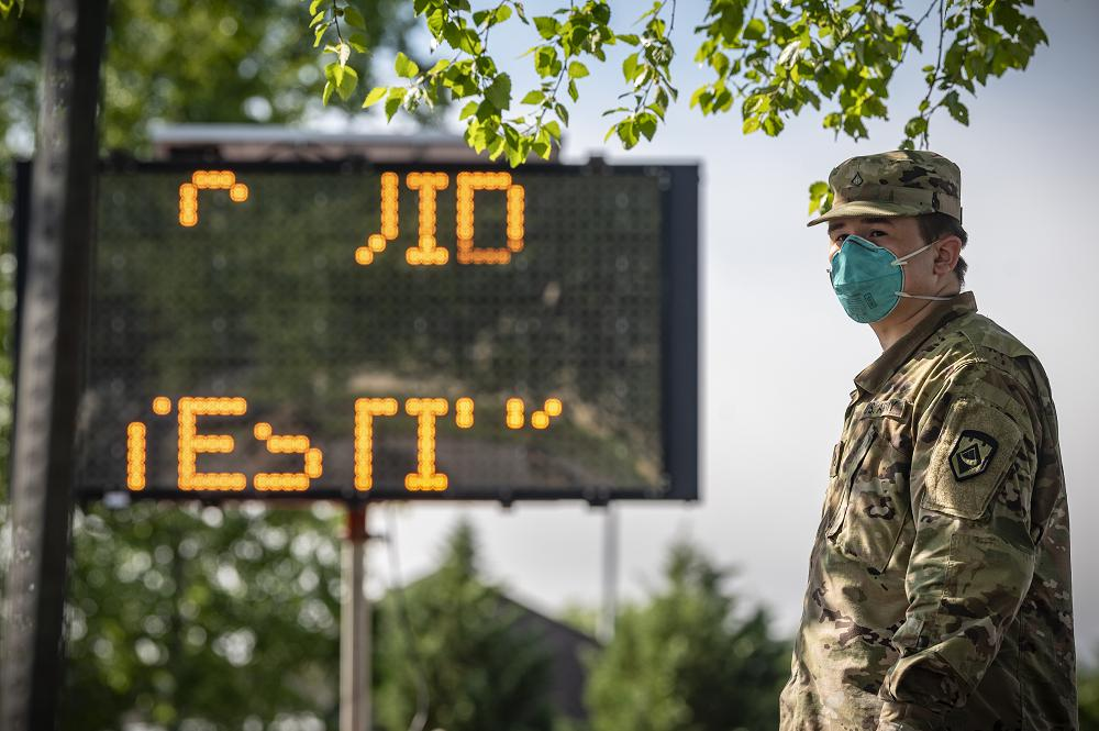 "A West Virginia National Guard Soldier waits for local citizens to arrive to be tested for COVID-19 on May 22, 2020 in Charleston, W.Va. The WVNG's Chemical, Biological, Radiological, Nuclear and Explosive (CBRNE) Battalion, the 35th Civil Support Team (CST), and the 35th Enhanced Response Force Package (CERFP), which make up Task Force CRE, and Task Force Medical personnel are highly trained in operating in a ""contaminated environment"" and have conducted more than 3,000 tests for COVID-19 in 87 lane support missions since the beginning of our response 70 days ago. (U.S. Air National Guard Photo by Staff Sgt. Caleb Vance)"