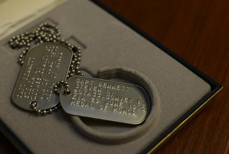 Replica dog tags for Medal of Honor recipient and OV-10 pilot Capt. Steven L. Bennett rest on a workstation at Hurlburt Field, Florida, Aug. 29, 2019. Bennett received the Medal of Honor for heroic actions performed while flying an artillery adjustment mission in Vietnam in June of 1972. Newly printed dog tags were presented to Bennett's daughter, Angela Bennett-Engele after the original dog tags went missing. (U.S. Air Force photo by Staff Sgt. Lynette M. Rolen)