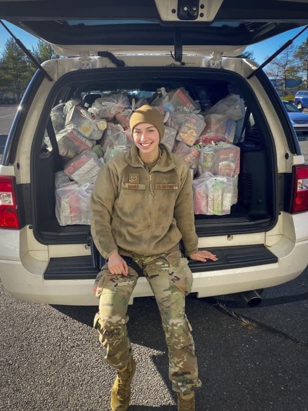 Senior Airman Alexis Maher, 103rd Security Forces Squadron defender, packs a vehicle with Thanksgiving meal kits at Bradley Air National Guard Base in East Granby, Connecticut, Nov. 16, 2020. Maher organized the squadron's second annual Thanksgiving food drive, in which 103rd Airlift Wing members helped donate a total of 120 family meal kits to food banks in six Connecticut towns. (Courtesy photo)