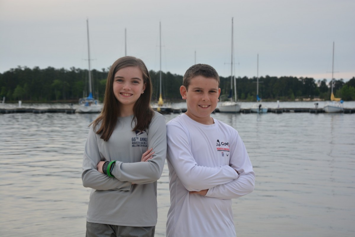 Katelyn and Grant Jr. Dietert, of Evans, pose for a photo at Clarks Hill Lake where the duo house their sailboats. The siblings seized an opportunity to enroll in a summer sailing camp two years ago through the Augusta Sailing Club and have grown to love the sport. Sailing is one of many activities they said they would not have thought to try if it wasn't for being part of the military family. (Laura Levering / Fort Gordon Public Affairs )