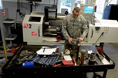 Illinois Army National Guard Sgt. Wesley Todd, of La Porte, Indiana checks the measurements on the device he invented at the machine shop in the Combined Support Maintenance Shop in North Riverside, Illinois, Sept. 21, 2016. Illinois Army National Guard photo by Staff Sgt. Robert R. Adams