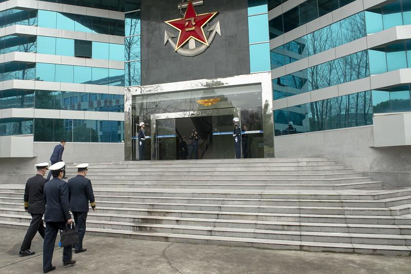 190115-N-ES994-0201 NANJING, China (Jan. 15, 2019) Chief of Naval Operations (CNO) Adm. John Richardson visits the People's Liberation Army (Navy) (PLA(N)) Command College for a roundtable discussion where he underscored the importance of lawful and safe operations around the globe. Richardson is on a three-day visit to Beijing and Nanjing to continue the ongoing dialog between the two militaries and encourage professional interactions at sea, specifically addressing risk reduction and operational safety measures to prevent unwanted and unnecessary escalation. (U.S. Navy Photo by Chief Mass Communication Specialist Elliott Fabrizio/Released)