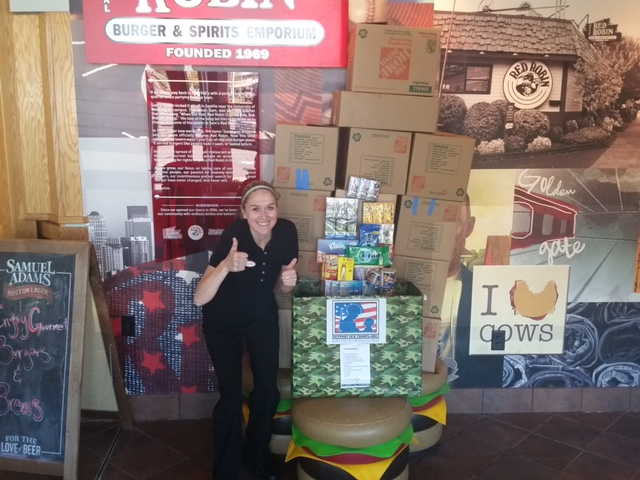 Nicole Jones poses with donations collected at a Red Robin
