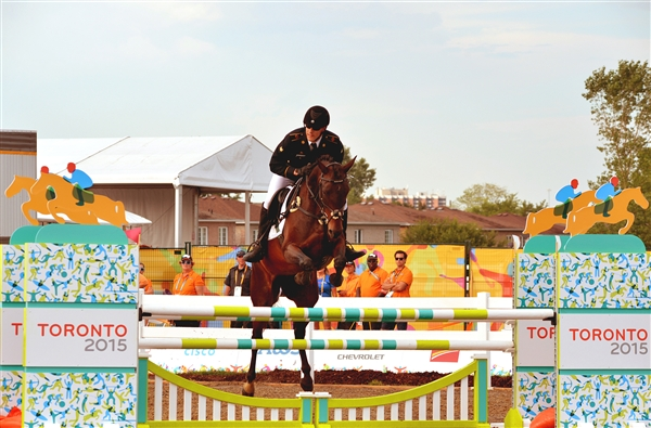 Army Spc. Nathan Schrimsher of the U.S. Army World Class Athlete Program rides a horse named Taboo, en route to earning a berth for the 2016 Olympic Games with a third-place finish in men's Modern Pentathlon at the 2015 Pan American Games in Toronto, July 19, 2015. U.S. Army photo by Tim Hipps